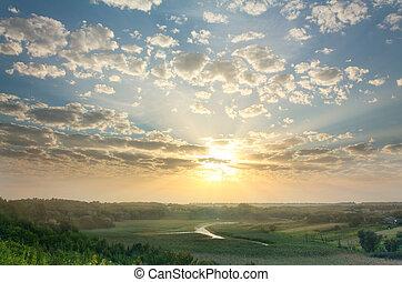 Magic summer sunset over rural expanses