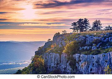Magic warm sunset and mountain stone cliff in Croatia