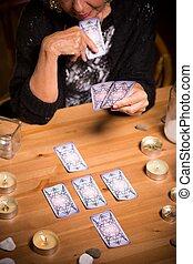 Magic woman using tarot cards - Photo of magic woman using ...