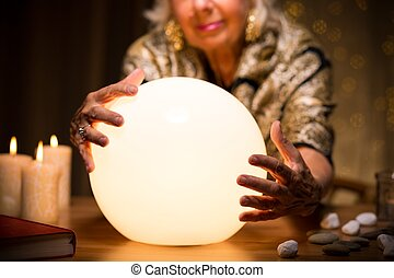 Magic woman with crystal ball - Close-up of magic woman with...
