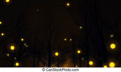 Magic Yellow lights fly up among dark forest trees - Magic...
