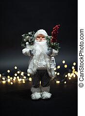 Magical jolly Santa Claus toy portrait shot against magical golden lights