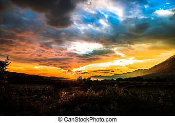 magical sunset over a valley with mountains around