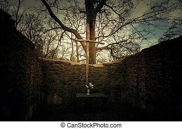 magical wooden cross crucifix in Pauline monastery ruin on the hungarian hiking trail near Badacsony .
