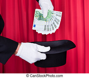 Magician Hand Holding 100 Euro Note From Hat