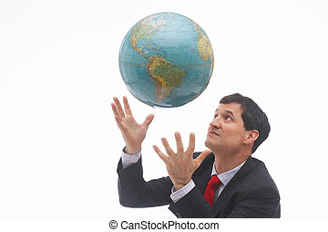 magician II - businessman concentrating on the flying globe...