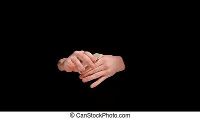 Magician makes playing card show concept on black...