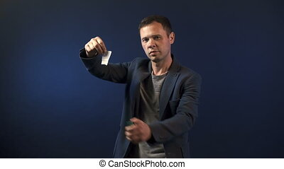 Magician man with paper and lighter - Video of magician...
