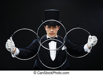 magician showing trick with linking rings - magic,...