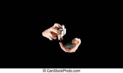 Magician starts showing his trick with cards, cardistry on...