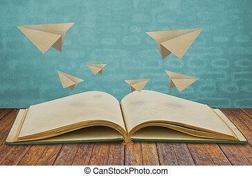 magisch, boek, met, papieren vliegtuig