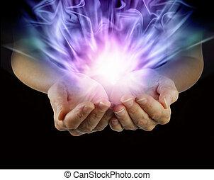 magisch, energie, in, tot een kom gevormde handen