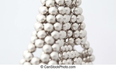 Magnet balls in triangular structure with holes, composition...