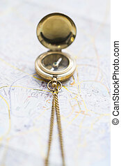 Magnetic compass on a blurry map