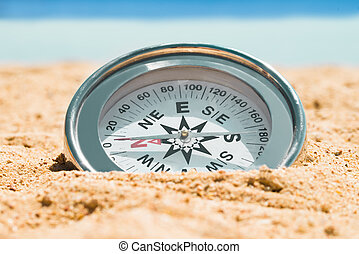 Magnetic Silver Compass On Sand
