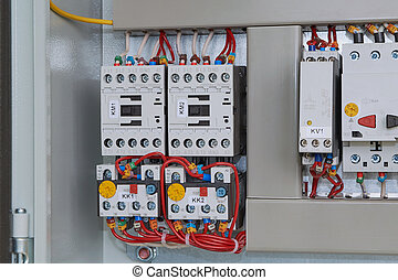 Magnetic starters with thermal relays connected by wires.