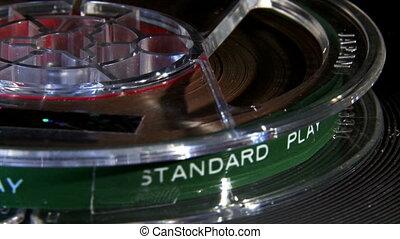 Magnetic tape, reel, closeup.