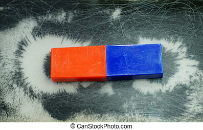 Magnetic - The photograph of a magnet and metal fragments....
