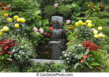Magnificent cascade fountain in well-known Butchard - garden...