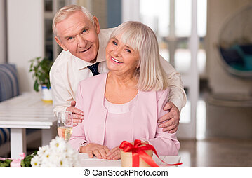 Magnificent elderly couple modeling for photo - Look at the ...