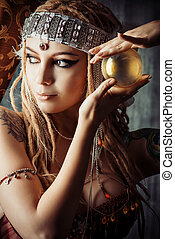 crystal ball - Magnificent fortune teller holding crystal...