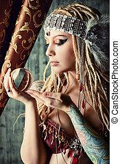 teller - Magnificent fortune teller holding crystal ball....