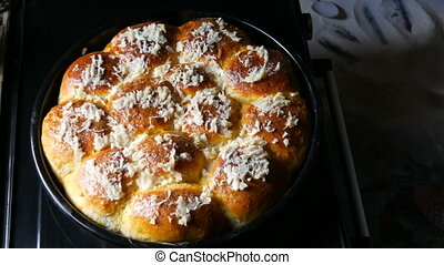 Magnificent fresh homemade baked pastries on which fresh garlic. Ukrainian buns.