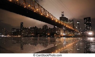 Magnificent low angle time lapse panorama view on night light illumination on modern Manhattan Brooklyn Bridge cityscape