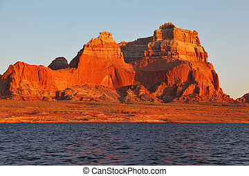 Magnificent red sandstone cliffs on the shores of Lake...