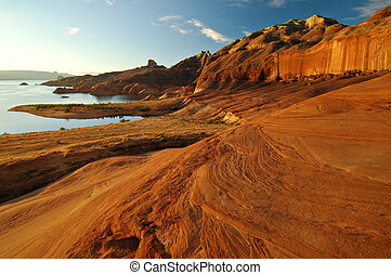 Magnificent red sandstone formations along the shores of Lake Powell, Arizona, United States.