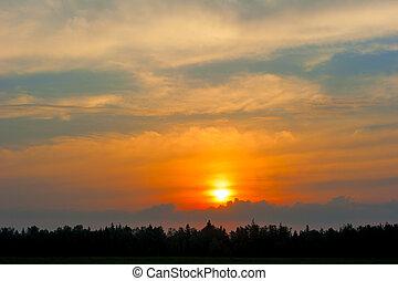 magnificent setting sun in orange tones