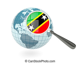 Magnified flag of saint kitts and nevis with blue globe