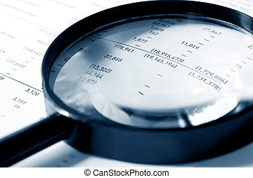 Magnifier over Figures - Magnifying glass over financial...