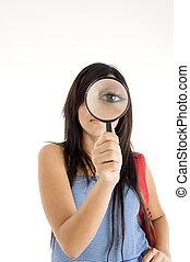 magnifying eye of girl - magnifying eye of young girl...