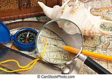 magnifying glass and a compass