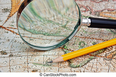 magnifying glass and a pencil on a