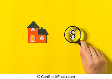 magnifying glass and home model
