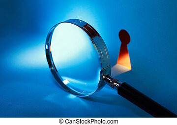 Magnifying Glass And Keyhole - Spying concept. Magnifying...