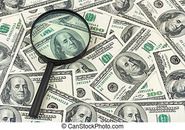 Magnifying glass and money - business background