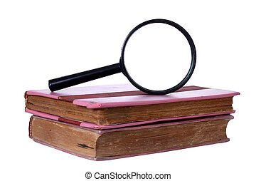Magnifying glass and old book, isolated on white