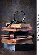 Magnifying glass and old book,