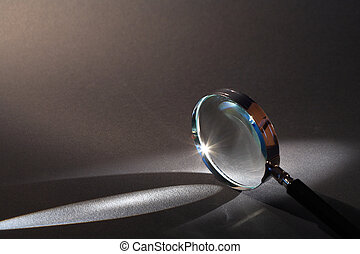 Magnifying Glass - Closeup of magnifying glass standing on...