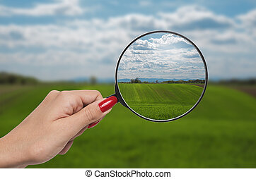 magnifying glass correcting vision of nature