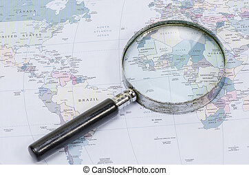 Magnifying Glass in front of a New York map