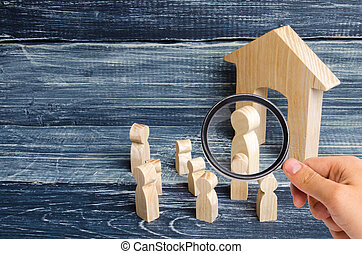 Magnifying glass is looking at the children gathered around the teacher. Lesson from the teacher, school lesson. The system of education, the process of teaching students and children, instruction.