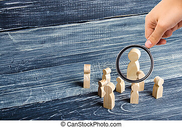 Magnifying glass is looking at the children gathered around the teacher. Lesson from the teacher, school lesson. The system of education, instruction. Classroom. Teacher and pupils.