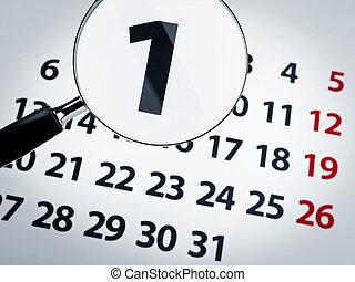 Magnifying glass on a calendar