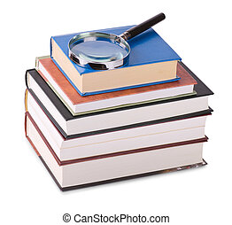 Magnifying glass on books - Magnifying glass on stack of...