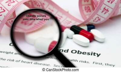 Magnifying glass on overweight and obesity concept