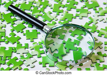 magnifying glass on the green puzzle